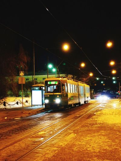 Transportation Illuminated Mode Of Transport Night Public Transportation Railroad Track Rail Transportation Tram Land Vehicle Cable Car No People Outdoors Sky