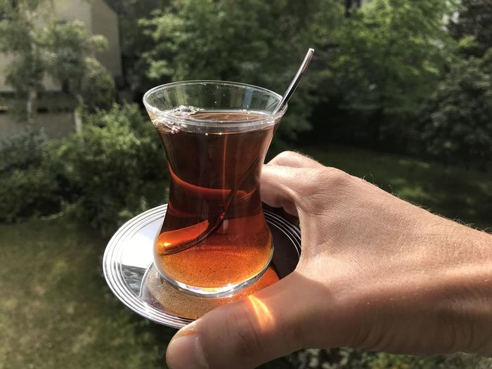Midsection of person holding tea cup
