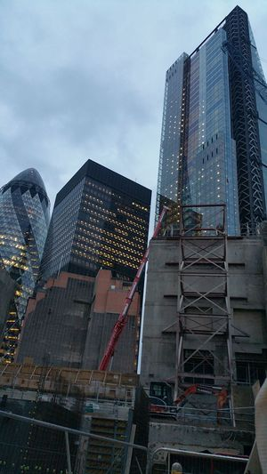 Construction and Demolition work at Tower 42 looking towards City Buildings in the Evening . Unseen London Leadenhall Building Cheesegrater Building Gherkin Building City Lights London New And Old Cityscape Old And New Looking Up Architecture City Lights