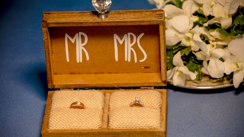 the wedding rings in the wooden box with Mr. and Mrs words Ring Wedding Wedding Photography Box - Container Celebration Close-up Communication Day Diamond Flower Gift Indoors  Life Events Nameplate No People Rings Table Text Wedding Ceremony Wedding Day Wedding Ring Wedding Rings