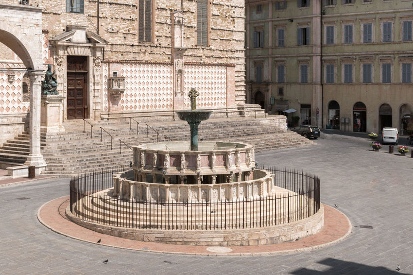 The Fontana Maggiore, a monumental medieval fountain, the main landmark of Perugia - Umbria, Italy. Ancient Architecture City Fountain Perugia Square Sunny Touristic Travel Building Building Exterior Fontana Maggiore Historic Italy Landmark Maggiore Medieval Monument No People Outdoors Statues Travel Destinations Umbria