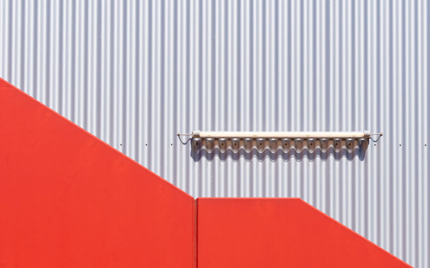 Full frame shot of red and silver wall