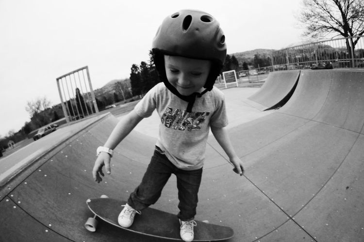 Boys Casual Clothing Childhood Cute Elementary Age Front View Full Length Halfpipe Happiness Helmet Innocence Leisure Activity Lifestyles Looking At Camera Person Portrait Skate Skateboard Skateboarding Skatepark Skating Smiling Standing Young Adult Young Men