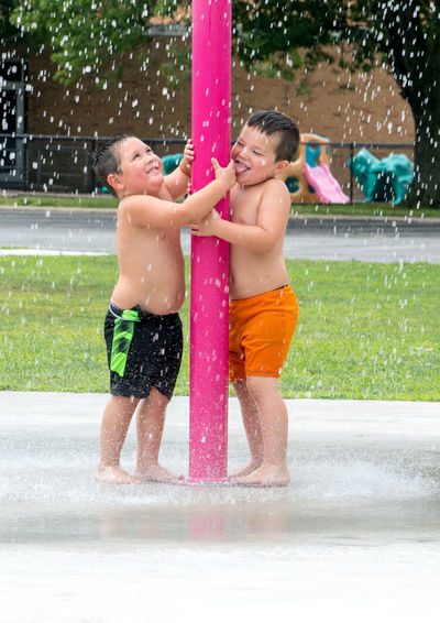 little boys play in a urban water park on a hot summers day Scales Water Wet Child Childhood Fun Males  Motion Enjoyment Nature Spraying Water Park Urban Fountain Caucasian Youth Culture Kids Summertime Seasonal Playground Fun Happy Boys Plant Pole The Photojournalist - 2019 EyeEm Awards The Street Photographer - 2019 EyeEm Awards