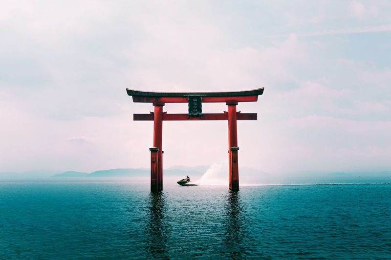 @itchban / itchban.com Japan Shrine Torii Gate Beauty In Nature Cloud - Sky Jetski Nature Outdoors Religion Shrine Sky Spirituality Summer Tranquility Travel Travel Destinations Water Waterfront The Traveler - 2018 EyeEm Awards