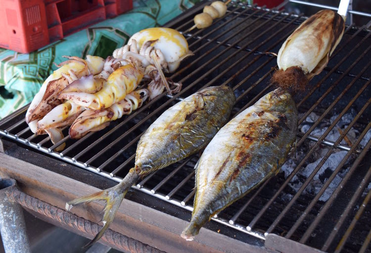 High angle view of fresh seafood on barbecue grill