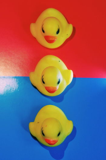 High angle view of yellow toy floating on table