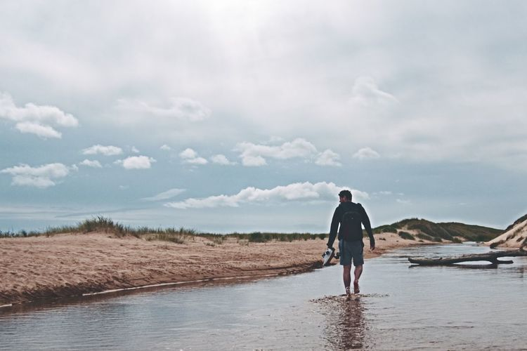 Balmedie Beach One Man Only One Person Beach Full Length Sea Walking Adult Cloud - Sky Sand People Outdoors Rear View Sky Tranquility Aberdeenshire Balmedie Beach Balmedie Scotland Ocean Beauty In Nature Sand Dune Coast One Young Man Only Discovery Tranquility