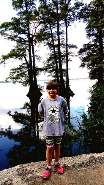Full Length Water One Person Childhood Front View Day Standing Tree Lake Outdoors Child Children Only People Puddle Sky Naturegirl Freshness One Boy Only Adult