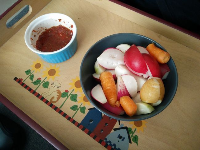 Today's Healthy Snack of Baby Carrots and giant Rainbow Radishes from the garden and Bruschetta dip Nom Nom Nom