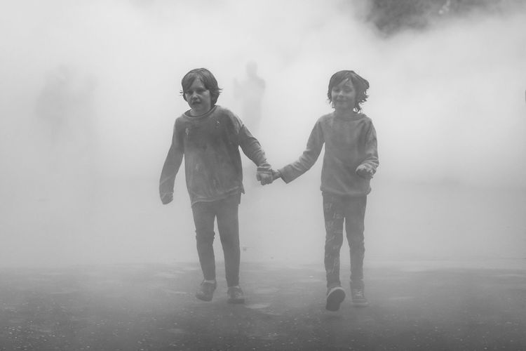 Holding hands, Tate Fog Exhibition London Real People Two People Childhood Togetherness Family Boys Full Length Fog Leisure Activity Lifestyles Wet Love Casual Clothing Happiness Day Outdoors Water Bonding Sky Holding Hands Art Is Everywhere Foggy TateModern London The Street Photographer - 2017 EyeEm Awards