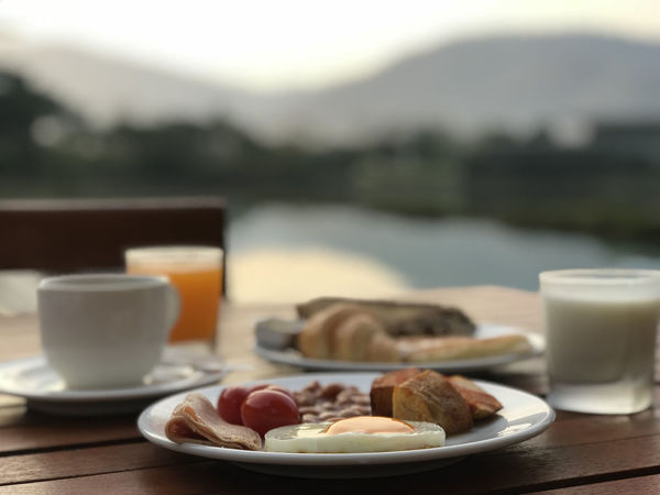 English breakfast on table with lake and mountain view Breakfast English Breakfast Food And Drink Delicious Healty Eating Sunrise