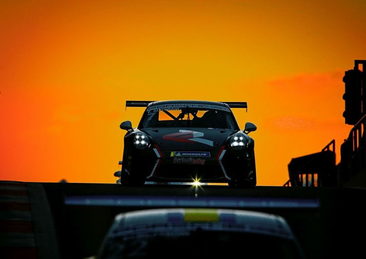 Sunset as the Porsche GT3 race cars leave the pits Silhouette Dusk Action Shot  Sports Photography Sunset GT RACING Porsche Mororsport Orange Color Car Sunset Technology Land Vehicle No People Outdoors Sky