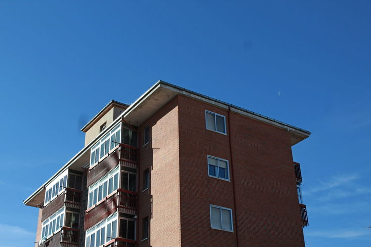 Building Building Exterior Sky Built Structure Architecture Window Blue Clear Sky Residential District Copy Space Day No People Low Angle View Nature Outdoors House Modern Education Sunlight City Apartment Shadow Shadows & Lights Bluesky Architecture Architectural Detail Street Streetphotography Brick Brick Wall Brick Building