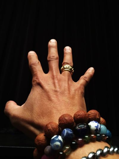 Close-Up Of Hand Gesturing Against Black Background