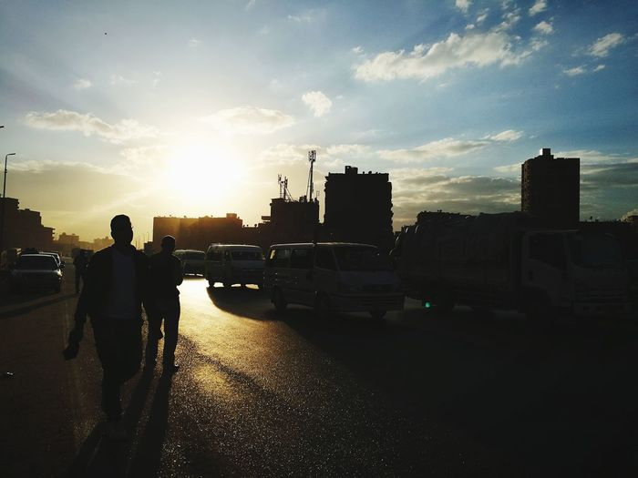 Life goes on.... Highway Sun Sunlight Sky Outdoors City People Cityscape Day EyeEm Ready   Sunset Street Walking Road Car Architecture Real People
