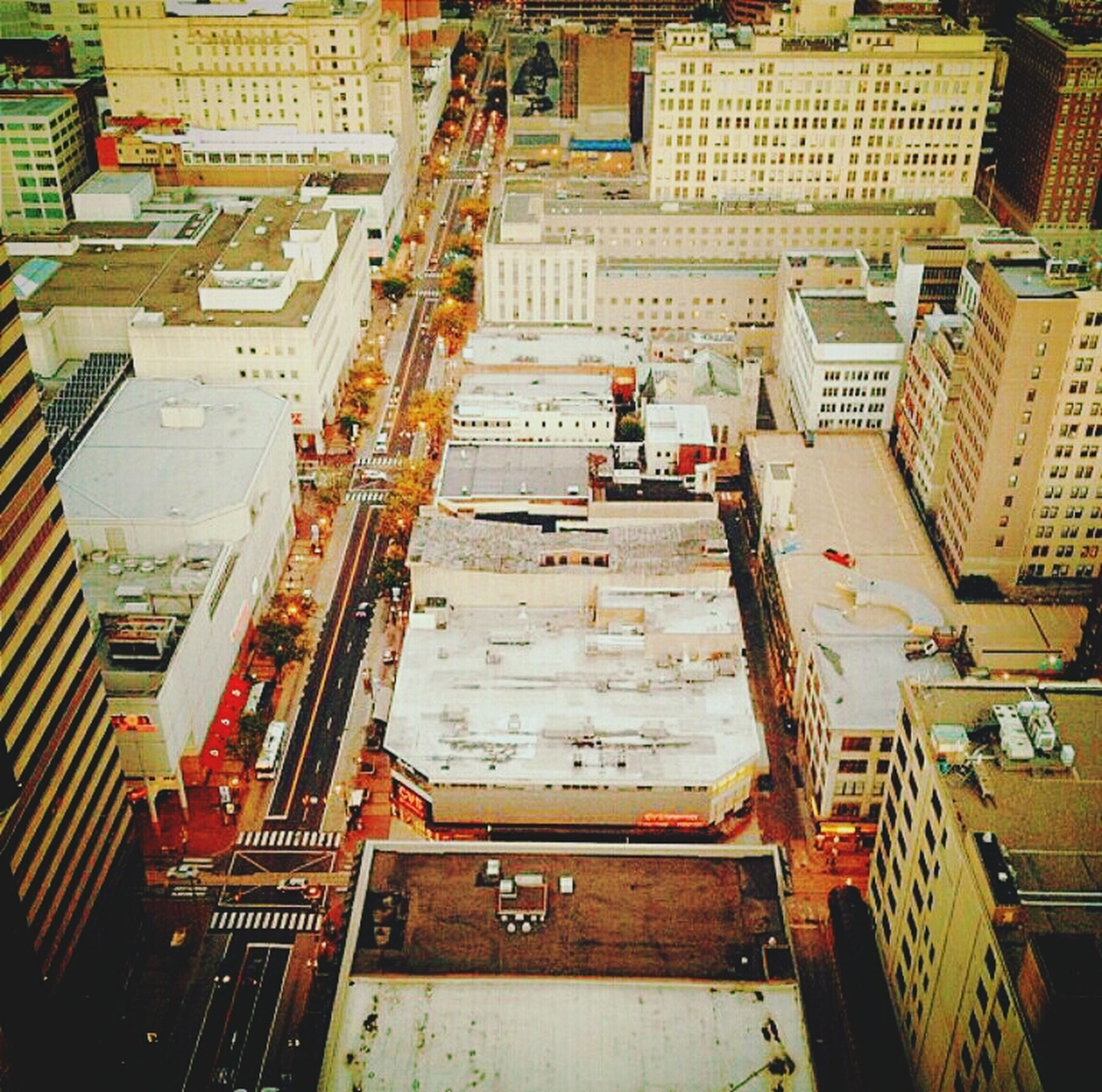 architecture, building exterior, built structure, city, high angle view, residential building, residential structure, building, city life, street, residential district, transportation, roof, incidental people, day, car, cityscape, outdoors, city street, house