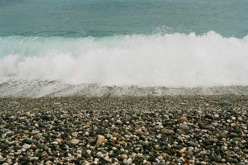 Waves splashing on rocks at beach