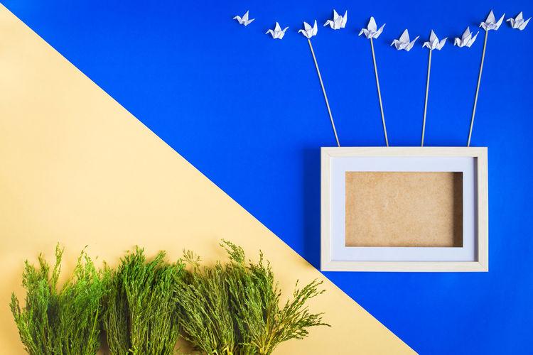 Craftwork on blue wall