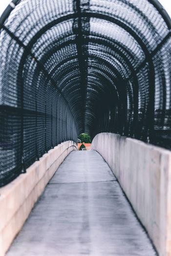 Empty footbridge with arch