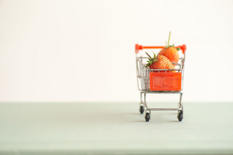 Closeup strawberries in the shopping trolley. Cart carrying the strawberry with the isolated background Copy Space Fruit Healthy Eating Studio Shot Wellbeing Shopping Cart Selective Focus Freshness