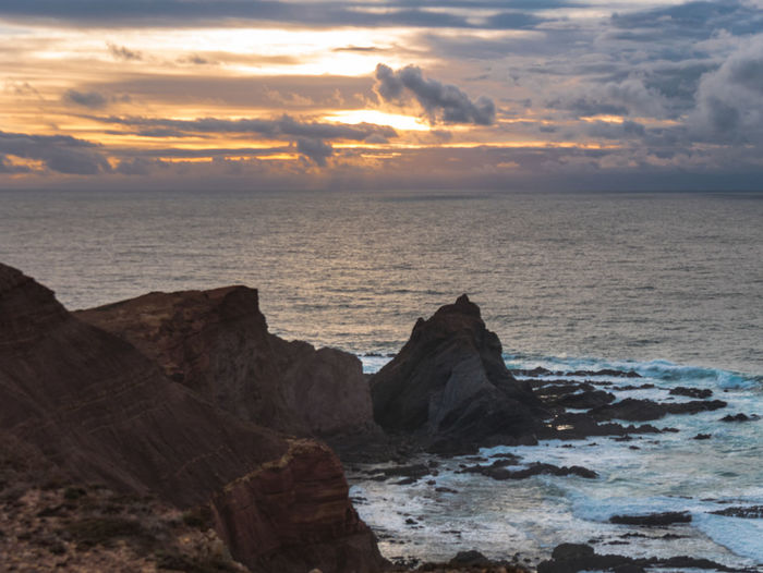 Cabo De São Vicente Portugal Algarve Sky Sea Sunset Water Beauty In Nature Cloud - Sky Scenics - Nature Horizon Over Water Tranquility Rock Tranquil Scene Horizon Solid Rock - Object Idyllic Nature Land Beach Rock Formation No People Outdoors Rocky Coastline