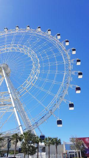 #Idrive # Orlando # Florida #EUA #beautiful day Clear Sky Ferris Wheel Arts Culture And Entertainment Blue Circle Sky