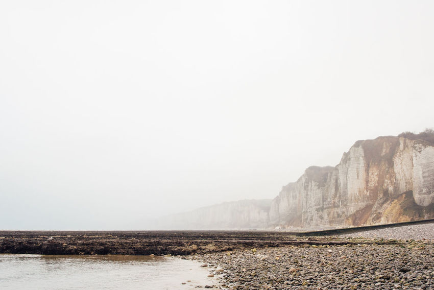 Cliff Fog Foggy Sea Seascape Ocean No People Beauty In Nature Beach Day Outdoors Low Tide Landscape Countryside Country Sky Tranquility Scenics - Nature Copy Space Tranquil Scene Nature Land Non-urban Scene Mountain Water Environment Idyllic Rock Climate Arid Climate