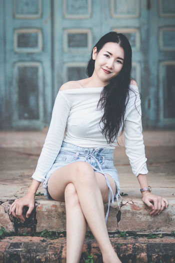 Young Adult Young Women Long Hair Hair One Person Beautiful Woman Lifestyles Real People Hairstyle Leisure Activity Beauty Full Length Women Portrait Fashion Looking At Camera Casual Clothing Sitting Focus On Foreground Black Hair Outdoors Teenager Smiling Smile Asian Woman