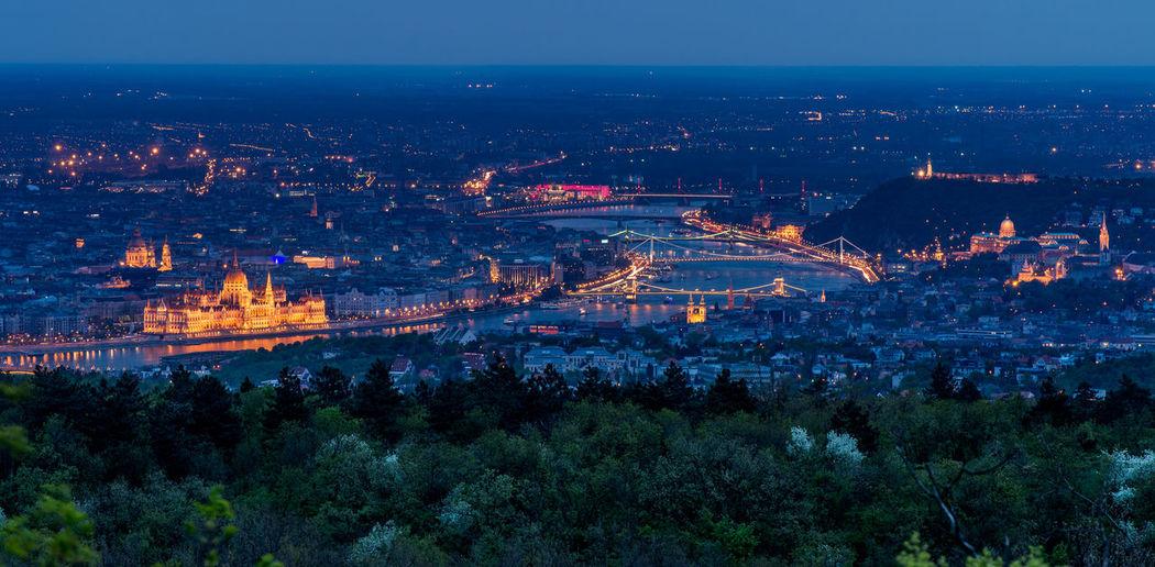 Illuminated cityscape during night