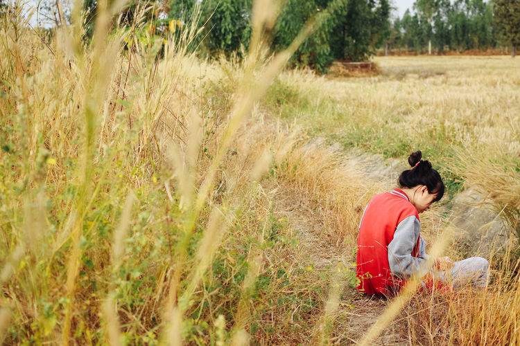 Adult Adults Only Agriculture Cereal Plant Crop  Day Farm Worker Farmer Field Grass Growth Landscape Mid Adult Nature One Person One Woman Only Only Women Outdoors People Plant Rural Scene Side View Timothy Grass Tranquil Scene Wheat