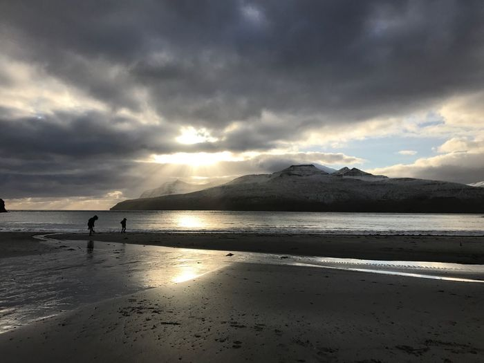 Tiny people at the beach Beach Tinypeople Faroe Islands