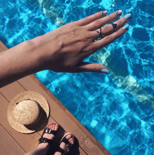High angle view of woman standing at poolside