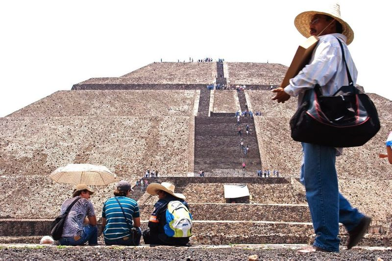 Mistico. Real People Hat Casual Clothing Day Pyramid Men Leisure Activity History Outdoors Architecture Travel Destinations Women Built Structure Lifestyles Boys Standing Full Length Building Exterior Childhood Ancient Civilization