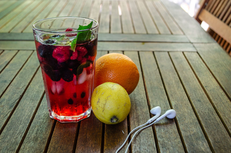 summer, holiday, feeling, cold lemonade with ice in a hot summer day at the garden Beverage Cube Earphones Ice Lemonade Music Orange RedBerry  Refreshment Tea Wood Beach Blueberry Chill Citrus Fruit Cold Garden Glass Lemon Mint Raspberry Strawberry Summer Table Water