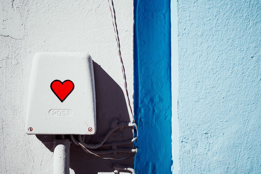 Simply Red Architecture Blue Building Exterior Built Structure Close-up Communication Day Emotion Guidance Heart Shape Love No People Outdoors Positive Emotion Red Sign Textured  Wall Wall - Building Feature White Color The Still Life Photographer - 2018 EyeEm Awards