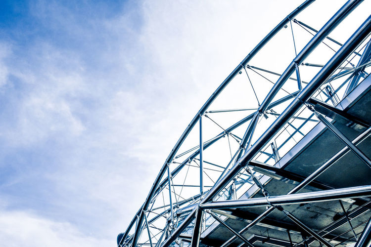 Ikhlas Built Structure Architecture Sky Low Angle View Day Nature Metal Building Exterior Blue Arts Culture And Entertainment Glass - Material Modern Railing Industry Outdoors Amusement Park No People Steel Cloud - Sky Staircase Leisure Activity Alloy Helix Bridge
