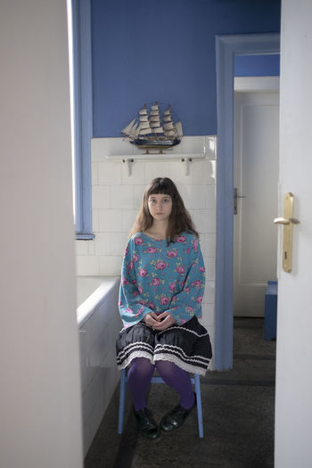 Portrait of a young female model sitting on the chair in the bathroom Beautiful BlueIsTheWarmestColour Dream Fairytale  Fine Art Photography Bathroom Beautiful Woman Blue Boat Boats Dreamy Drepression Eyes Fine Art Girl Melancholy Moody Portrait Sad Sadness Sky Young Adult