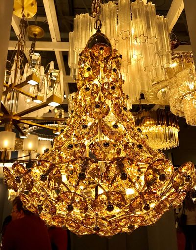 Close-up of illuminated chandelier hanging on ceiling