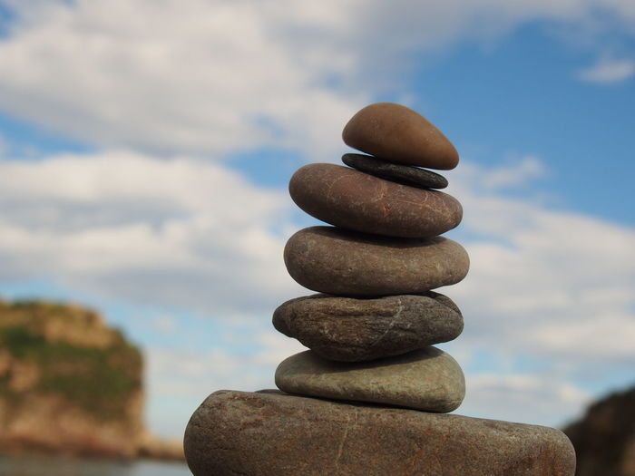 Close-up of stack of stones by the beach