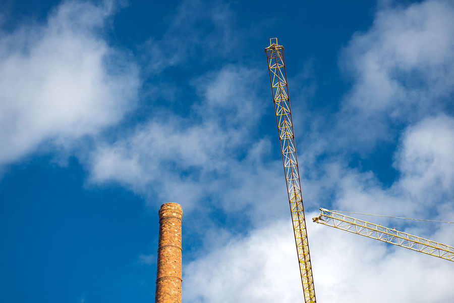 industrial background with construction cranes and chimney, blue sky Baltic Blue Business Business Finance And Industry Chimney City View  Cloud - Sky Concept Conceptual Construction Cranes Economics Economy Estonia Exceptional Photographs Geometry Industrial Industry Landscape Low Angle View Sky Take Photos Tallinn Urban Yellow