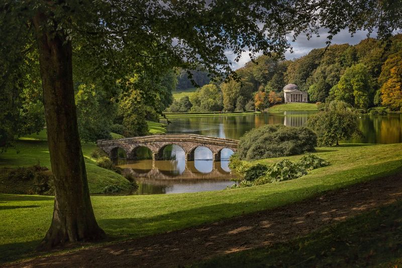 Capability Brown landscape Plant Tree Architecture Built Structure Nature Growth Water Arch Park Day Green Color No People Park - Man Made Space Tranquility Sunlight Formal Garden Connection Garden Grass Bridge - Man Made Structure