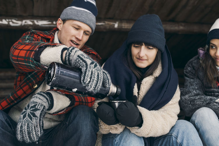 Young couple sitting in snow