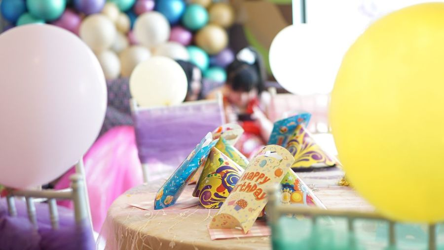 Various objects on table during birthday party