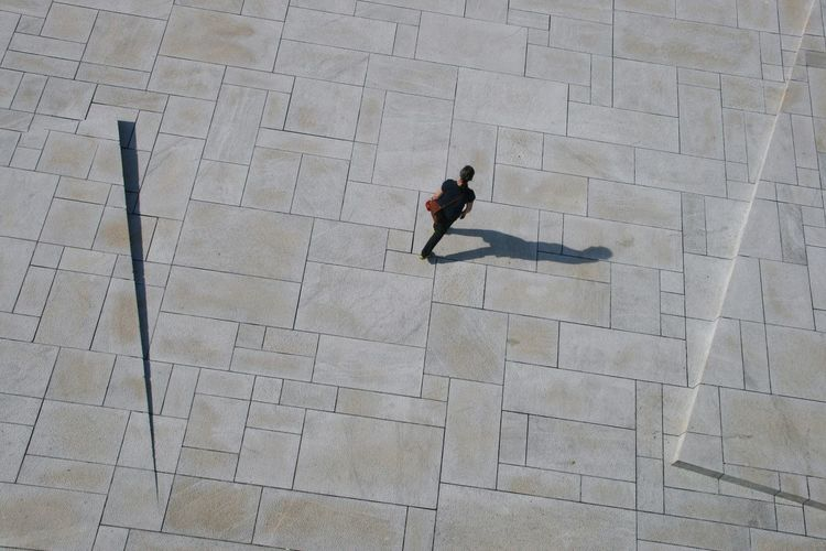 High angle view of man walking on floor
