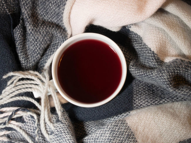 Drink Cup Tea Refreshment Close-up Hot Drink Food And Drink Mug Human Body Part Tea - Hot Drink Adult Red Tea Cup One Person Indoors  Sweater Warm Clothing Clothing Winter Relaxation Drinking Black Tea