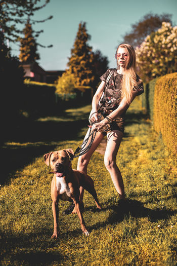 Canine Dog Domestic Domestic Animals Emotion Full Length Leisure Activity Lifestyles Mammal Mouth Open One Animal Outdoors People Pet Owner Pets Plant Real People Running Women Young Adult My Best Photo 17.62°