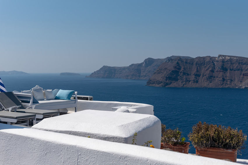 View of Oia - Santorini Cyclades Island - Aegean sea - Greece Greece Santorini Oia Island Maditerranean Sea Volcano Caldera Aegean Cyclades Water Mountain Clear Sky Nature Scenics - Nature Architecture Blue Beauty In Nature Built Structure Sunlight Tranquil Scene Tranquility Outdoors Mountain Range Swimming Pool