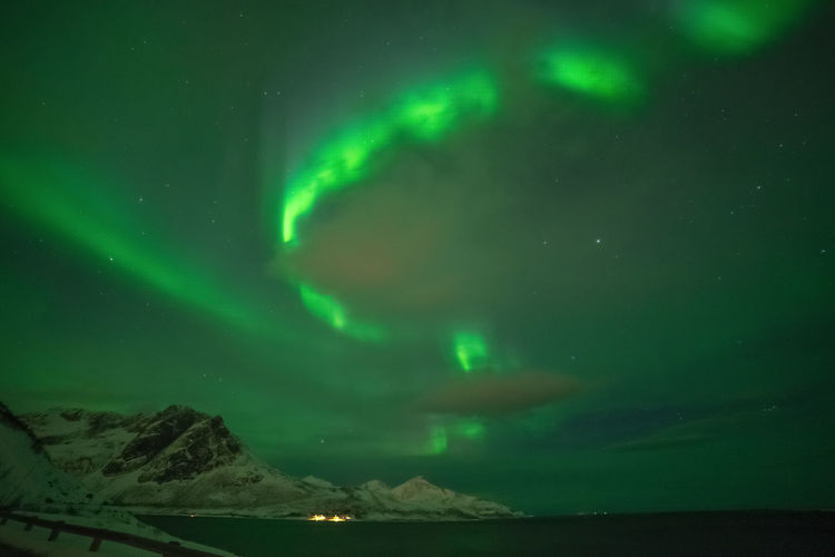 Aurora Borealis over Grøtfjord Geomagnetic Disturbance Kp-index Northern Lights Polar Lights Astronomy Aurora Polaris Beauty In Nature Cold Temperature Dramatic Sky Environment Geomagnetic Storm Green Color Idyllic Landscape Majestic Mountain Nature Night Scenics - Nature Sky Solar Storm Space Star - Space Tranquil Scene Tranquility