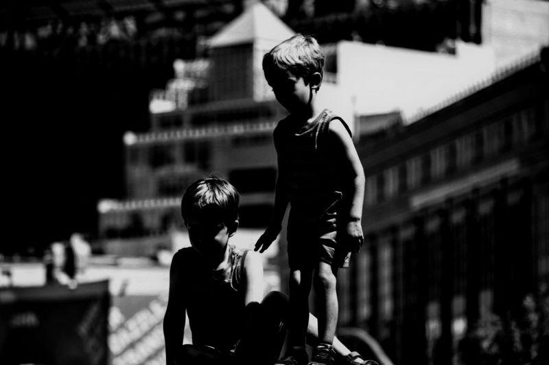 Boy and girl looking at camera